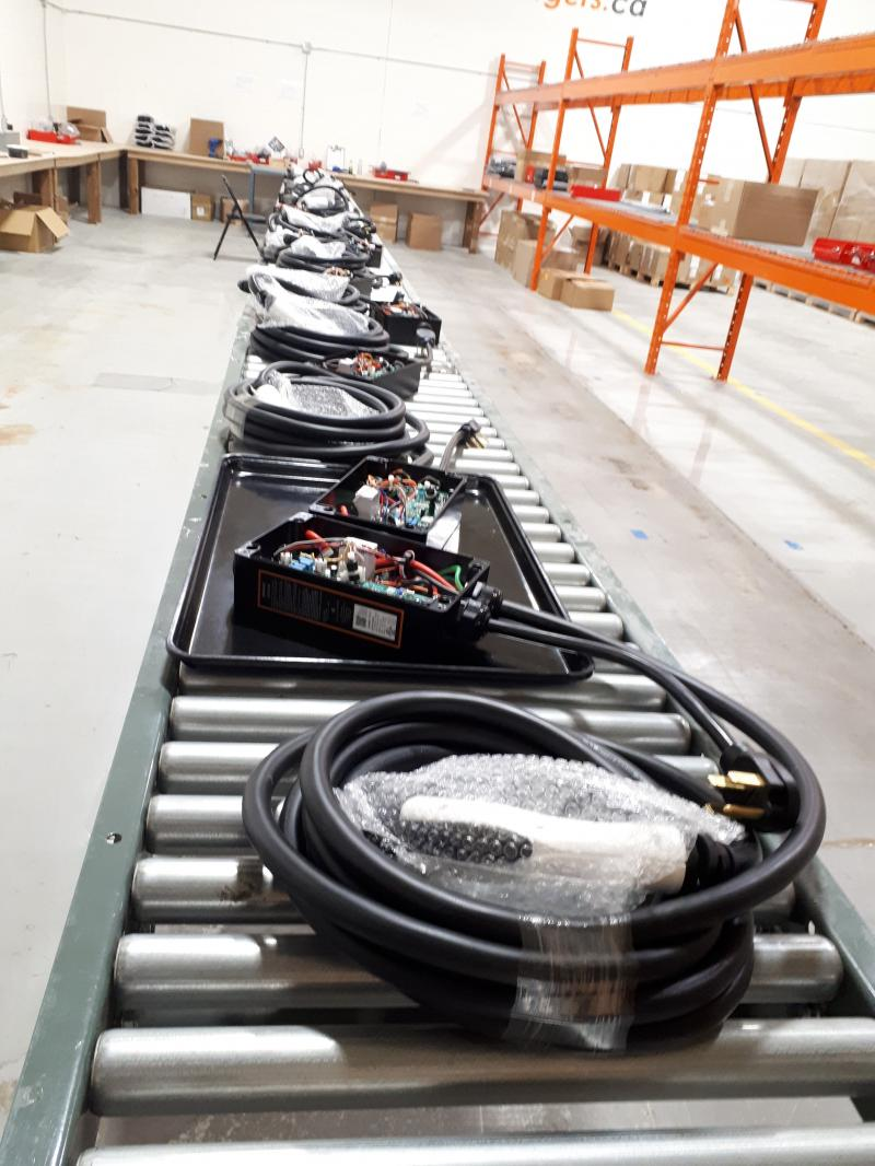 Another Milestone.  First Conveyor Full of JuiceBox Pro 40 Plug Chargers. - Photo